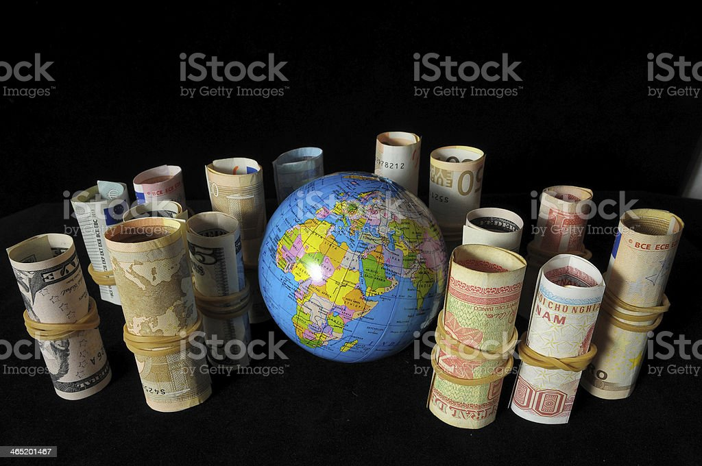 Planet Earth and Rolled Money stock photo