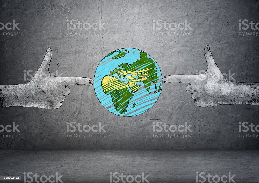 Planet Earth between two hand drawn hands making shooting gesture stock photo