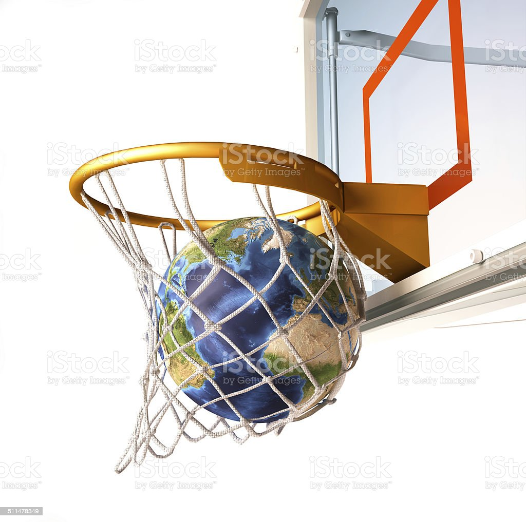 Planet earth falling into the basketball basket. stock photo