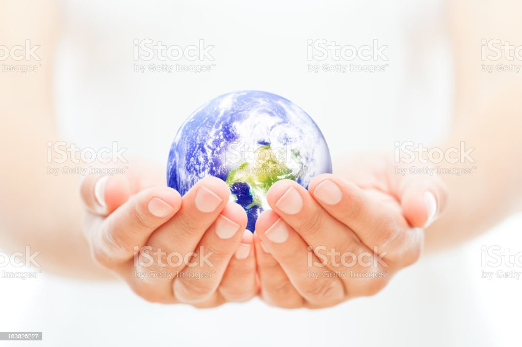 Planet Earth held in a woman's cupped hands royalty-free stock photo