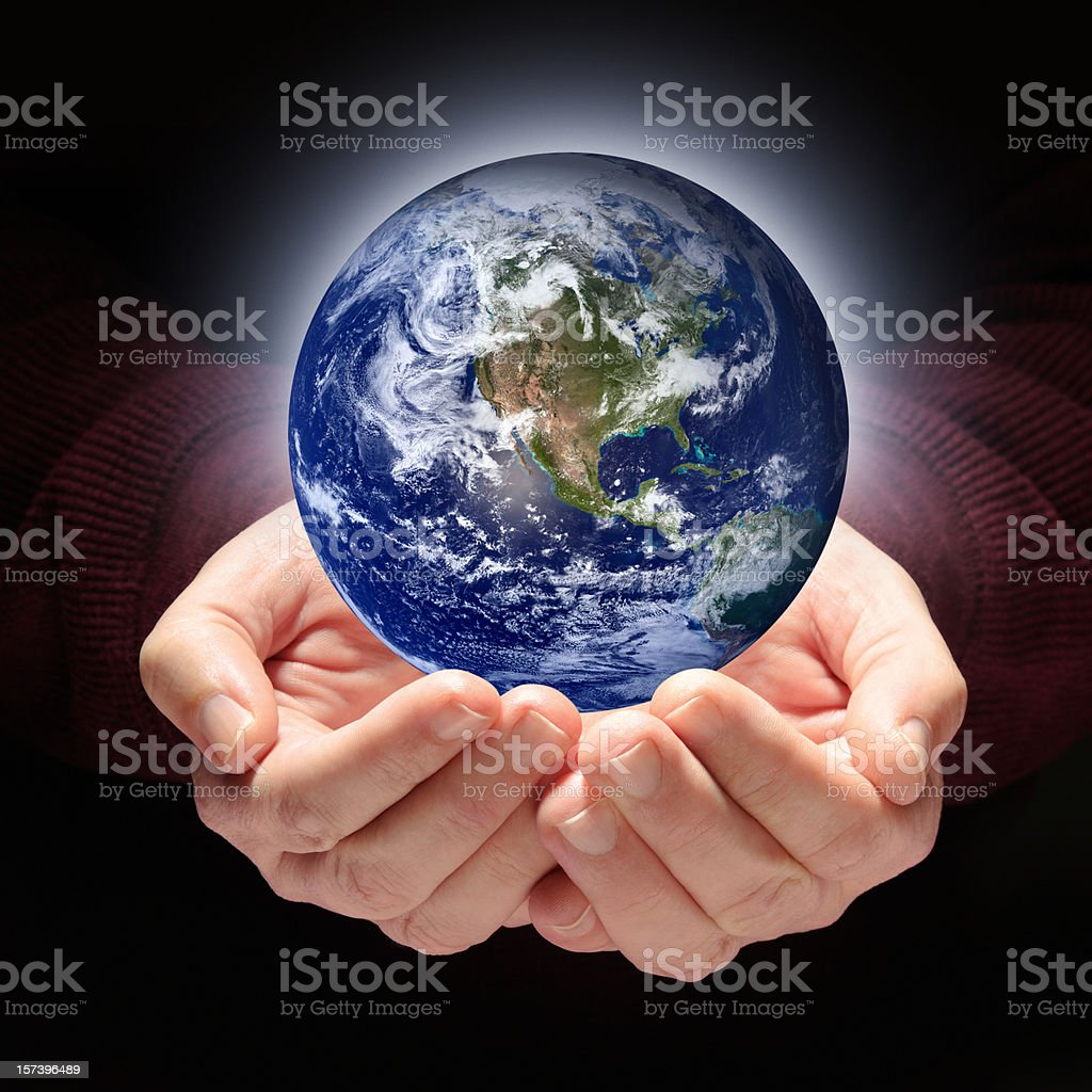 Planet Earth Held in Nurturing, Protecting Hands royalty-free stock photo