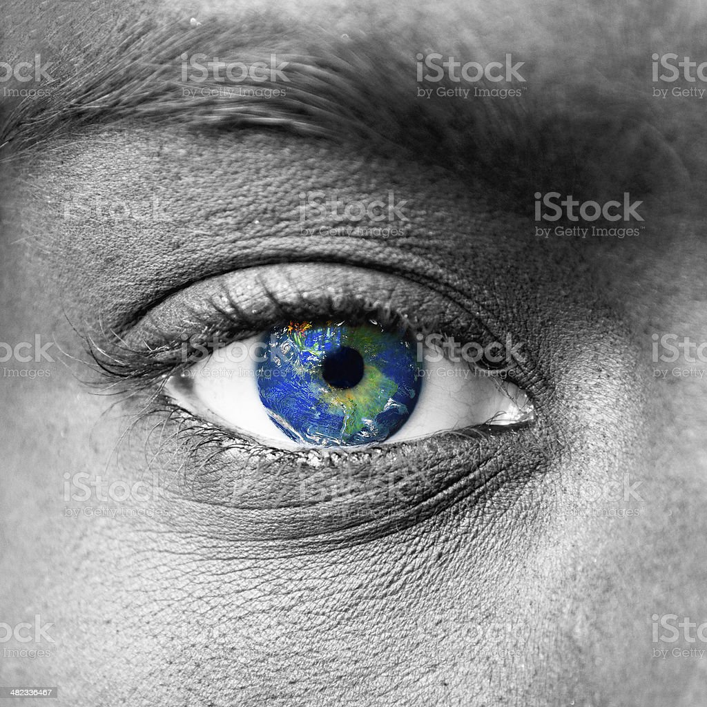 Planet earth in blue human eye stock photo