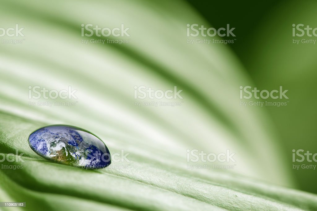 Planet earth in drop of water stock photo