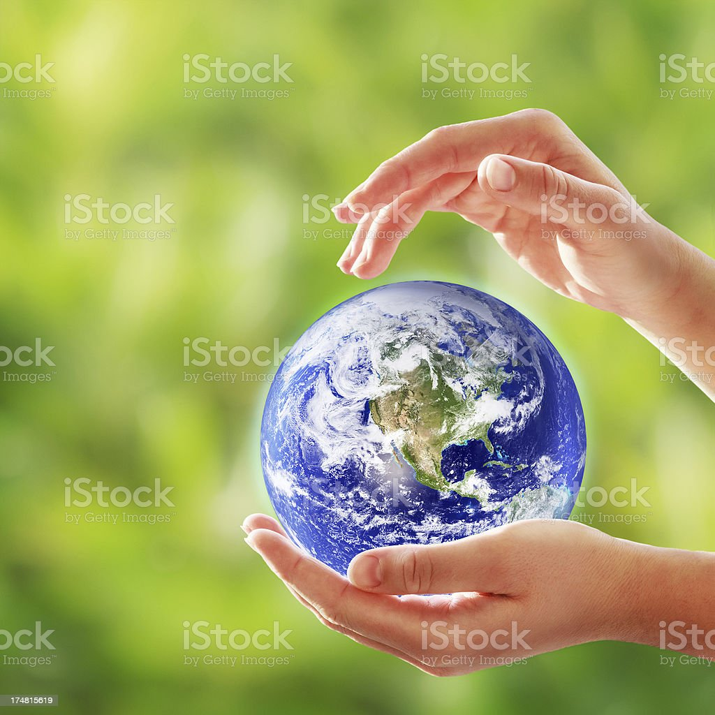 Planet Earth In Female Hands royalty-free stock photo
