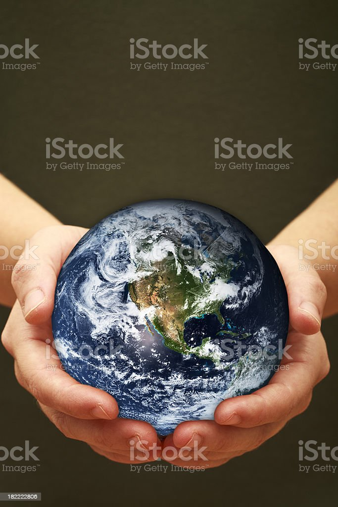 Planet Earth in our hands stock photo