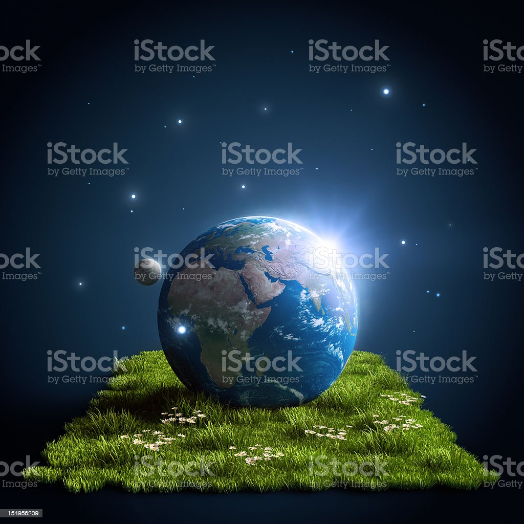 Planet Earth on green grass stock photo