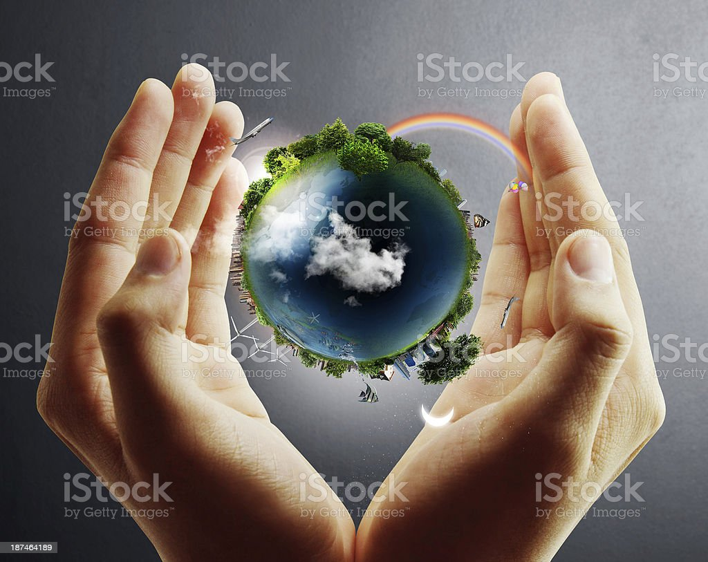 Planet Earth shown between the hands of a person stock photo