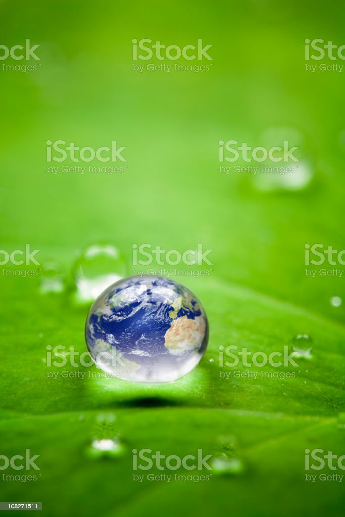 Planet earth waterdrop. Environment Globe Water Leaf Nature World stock photo