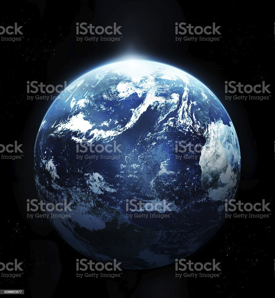 Planet earth with sun rising from space stock photo