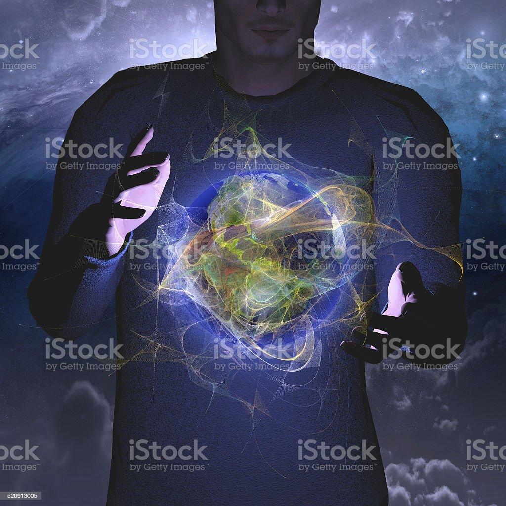 Planet hovers between hands stock photo