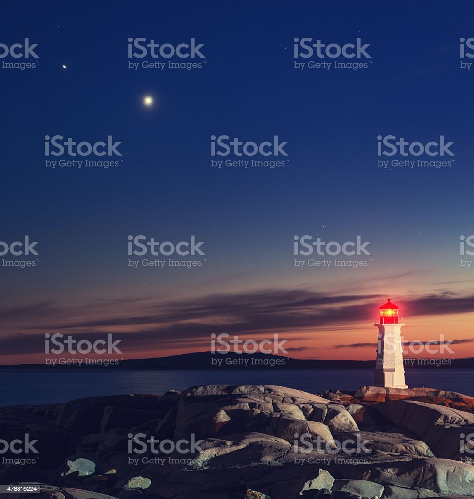 Planets Over Peggy's Cove Lighthouse stock photo