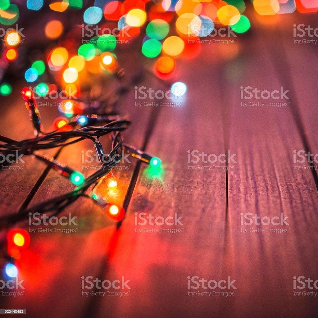 Plank wood with christmas lights stock photo