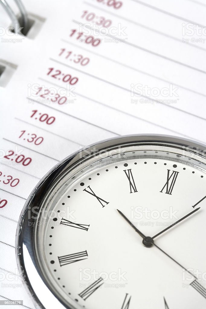 Planner  and clock stock photo