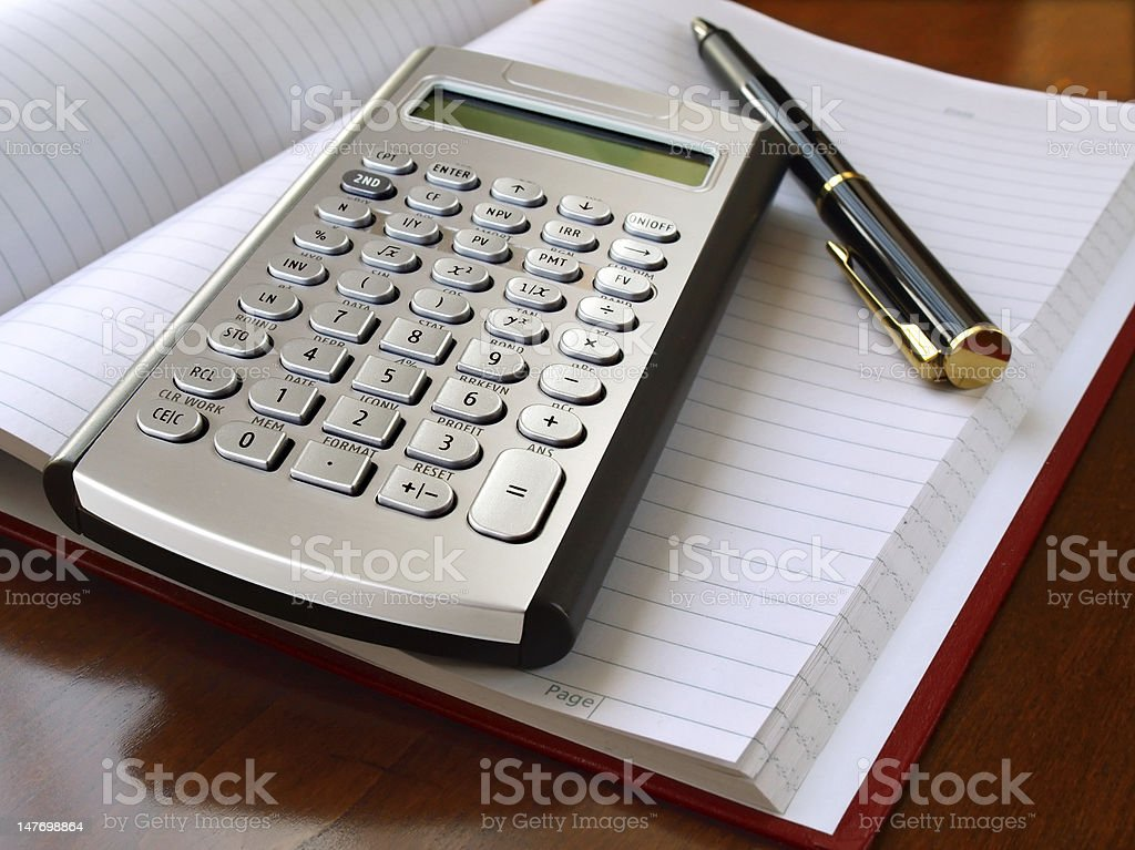 Planner with Calculator and Pen royalty-free stock photo