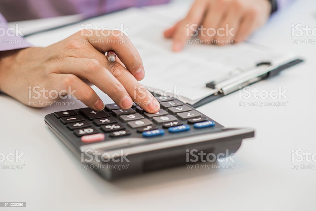 planner with pen and calculator on the table stock photo