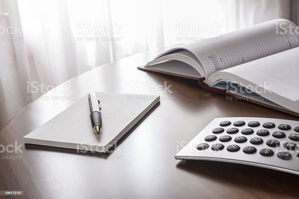 planner with  pen and calculator royalty-free stock photo