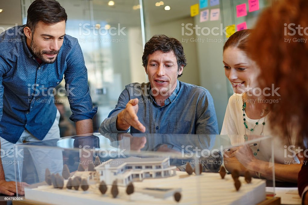 Planning around their client's specifications stock photo