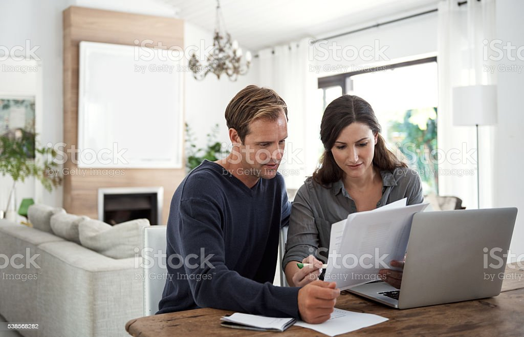 Planning for the future with a budgeting session stock photo