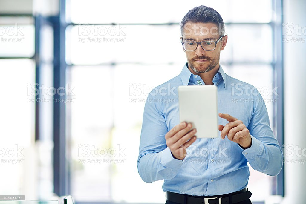 Planning his business moves using wireless technology stock photo