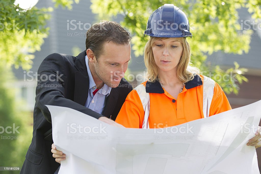Planning, looking at blueprint royalty-free stock photo