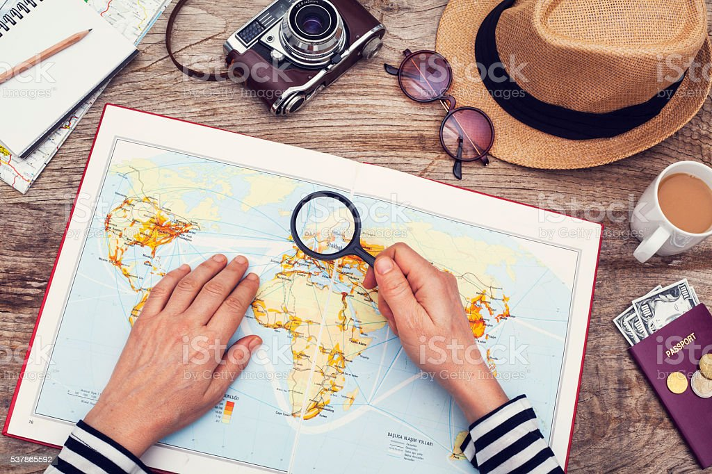 Planning vacation with map stock photo