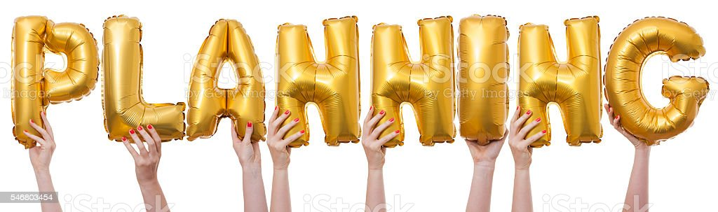 Planning word made from gold balloons stock photo