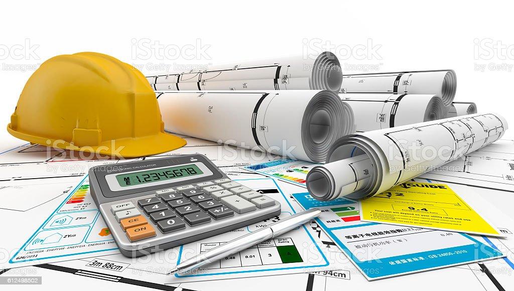 Planos arquitectónicos enrollados junto a casco amarillo. stock photo