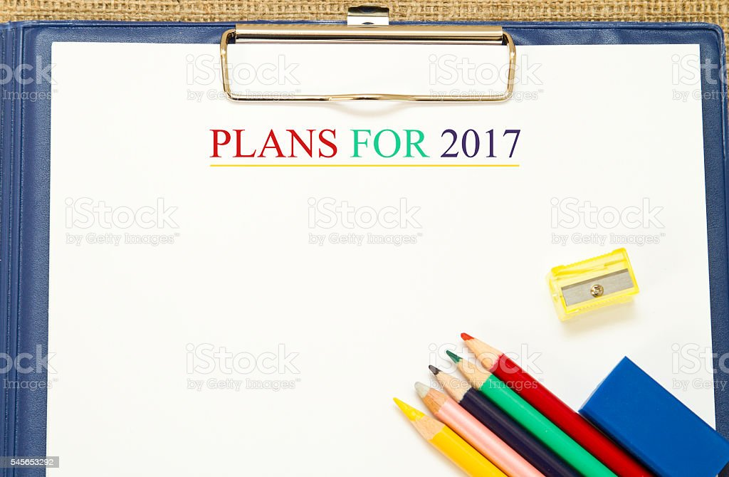 Plans for 2017 written on a white paper stock photo