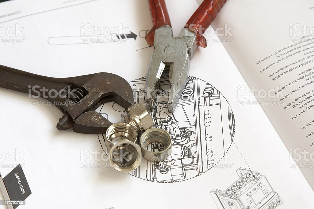 Plans Wrench nuts and pliers royalty-free stock photo