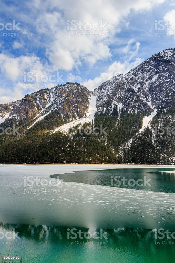 Plansee lake frozen on the end of winter, Tyrol, Austria. stock photo