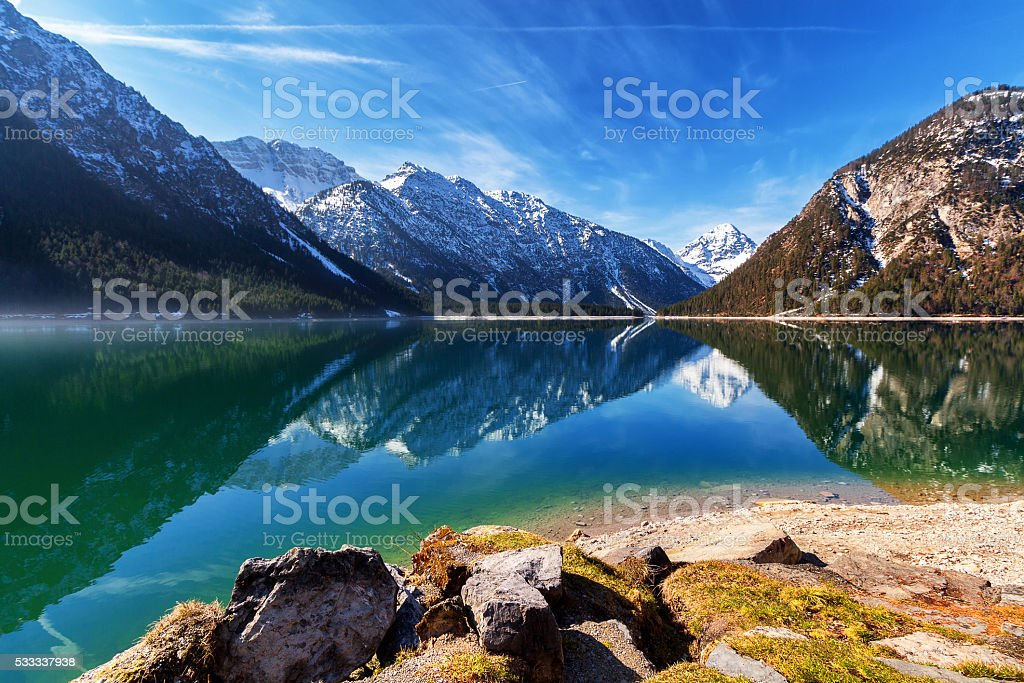Plansee lake spring panorama with snow on mount top stock photo