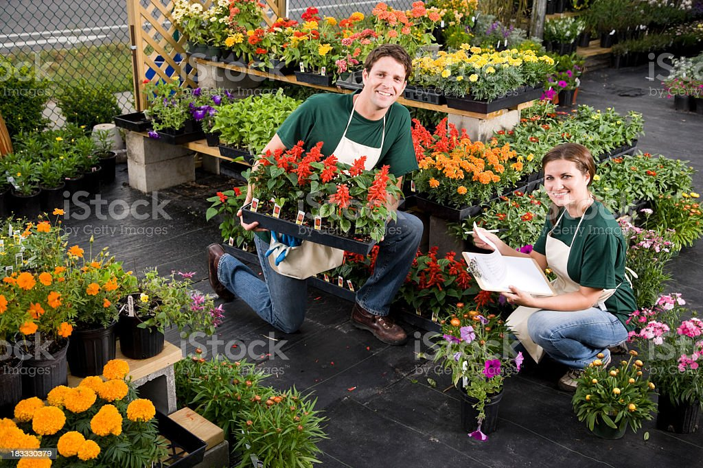 Plant nursery retail store worker taking inventory stock photo