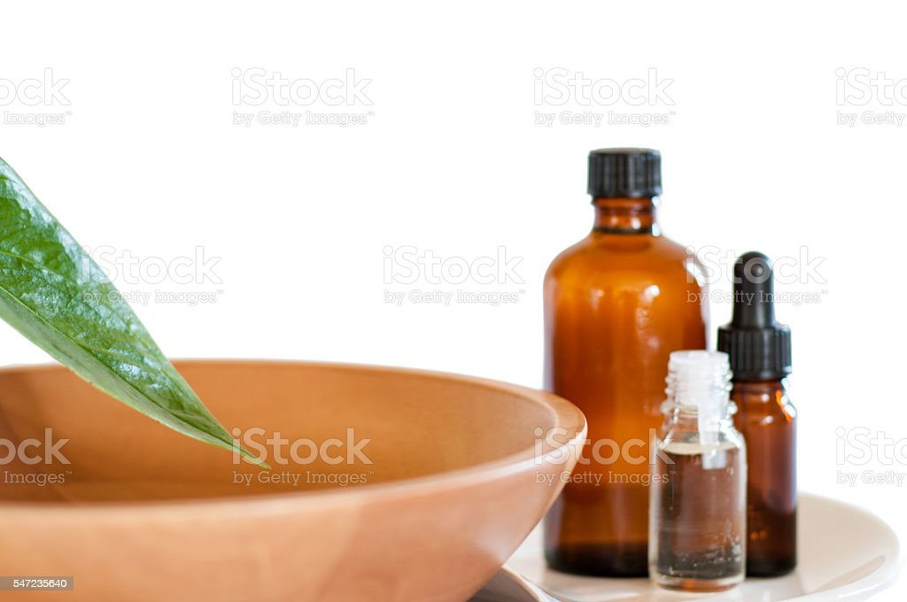 Plant Overhead An Assortment Of Oils Resting On Rose Petals stock photo