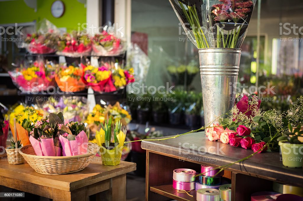 Plant pots and bouquet on table stock photo