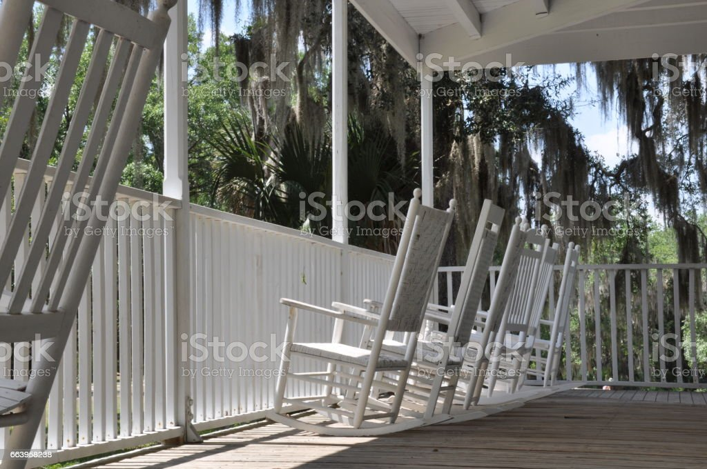 Plantation Style Covered Porch With Rocking Chairs stock photo