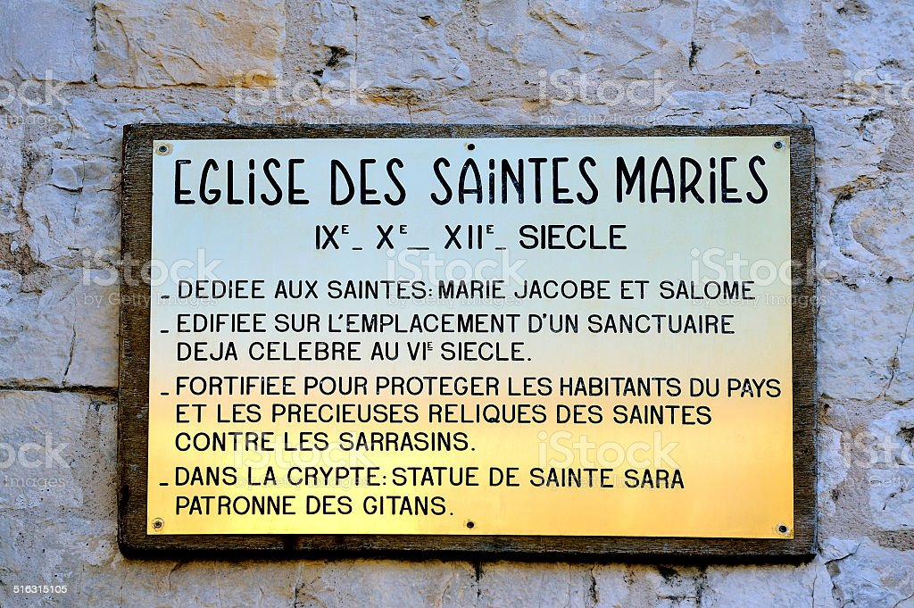 plaque explaining the history of the church of Saintes-Maries-de-la-Mer stock photo