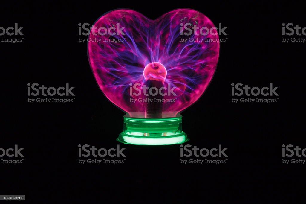 Plasma ball heart glowing in the dark stock photo