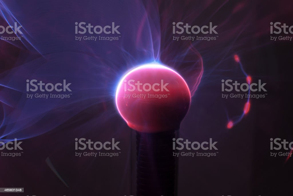 Plasma ball with smooth magenta-blue flames stock photo