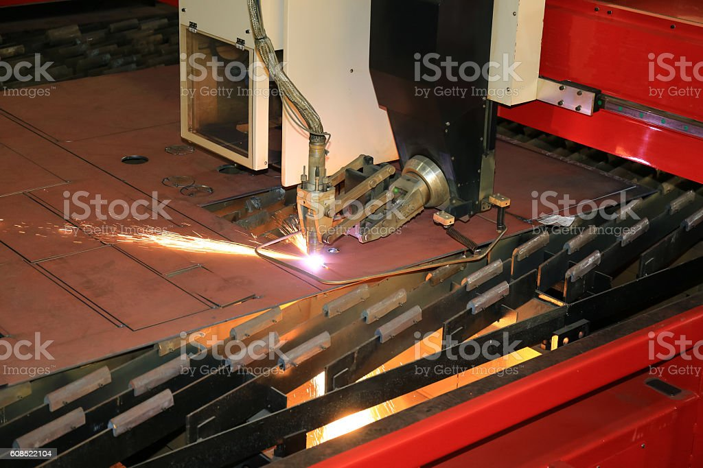 CNC Plasma cutter cutting multiple pieces stock photo