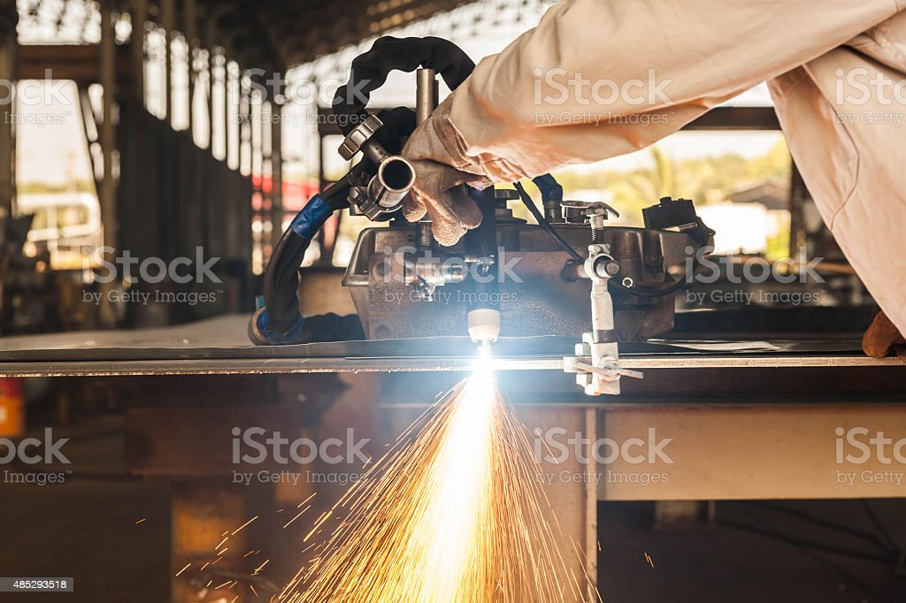 Plasma cutting process of metal material with sparks stock photo