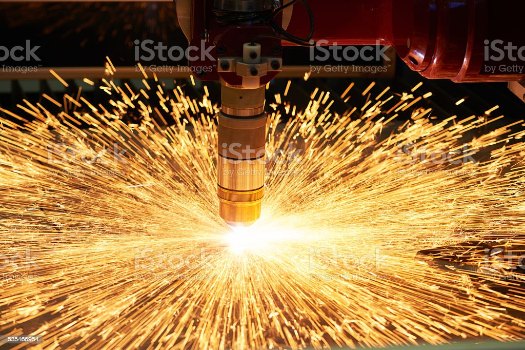 plasma or laser cutting metalworking with sparks stock photo