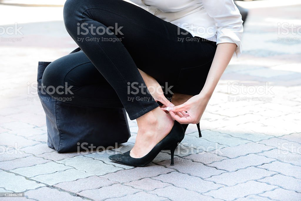 Plaster applied to blister on foot stock photo