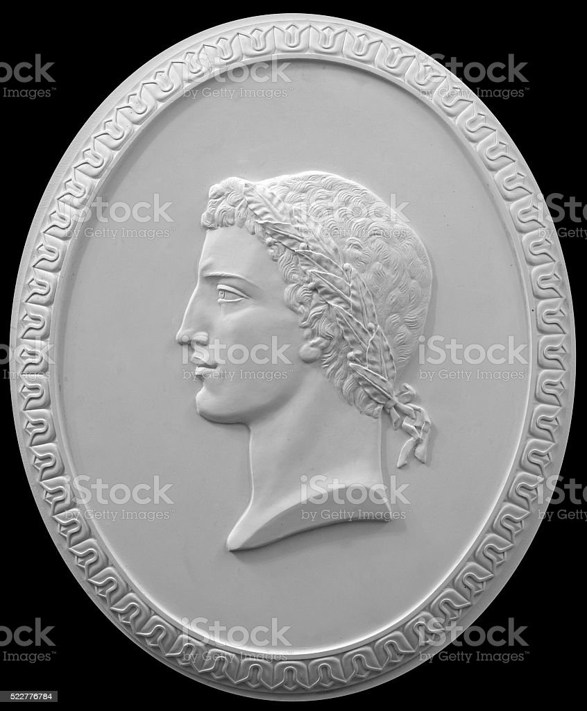 plaster bas-relief Greek characters on a white background stock photo