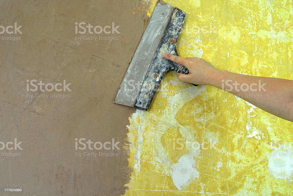 plaster filling wall repair decoration royalty-free stock photo