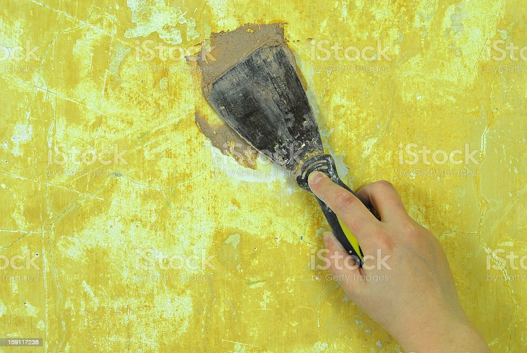 plaster filling wall repair royalty-free stock photo