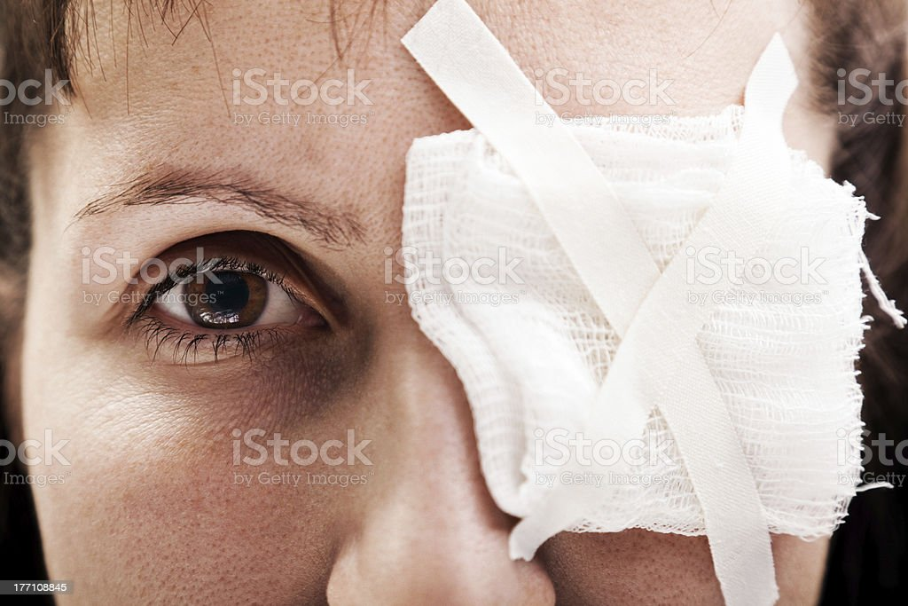 A plaster patch covering a person's wounded eye stock photo
