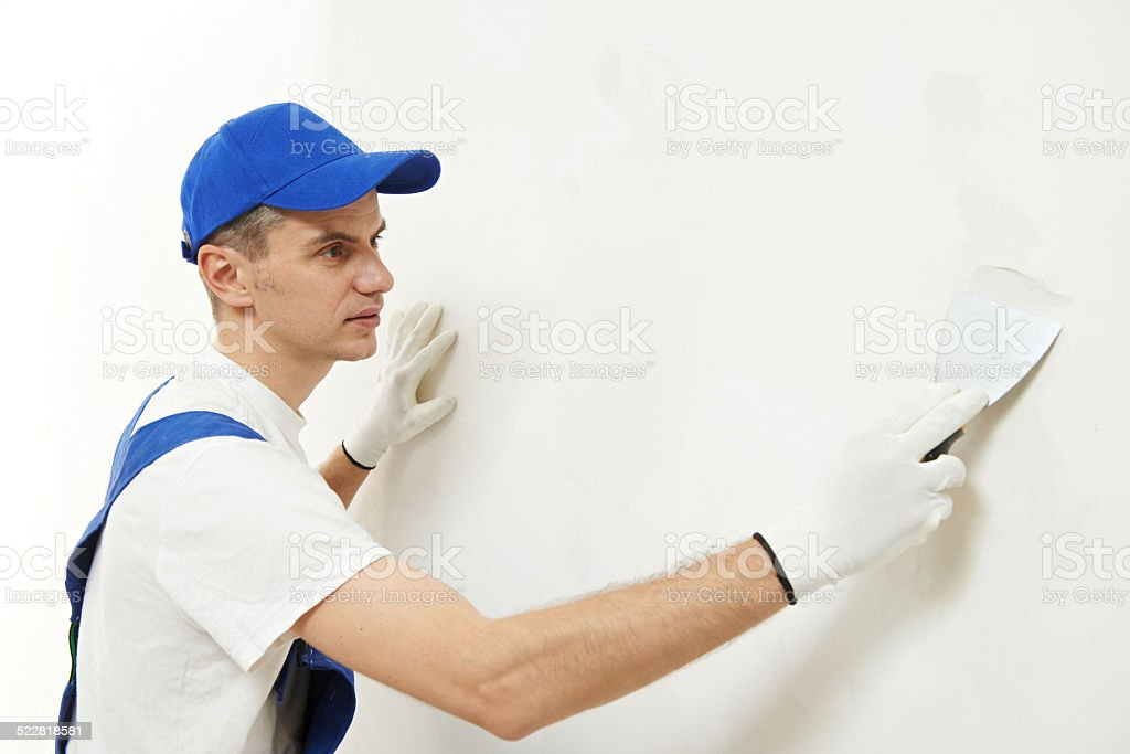 Plasterer at indoor wall work stock photo