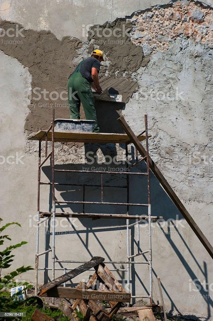 Plasterer at work stock photo
