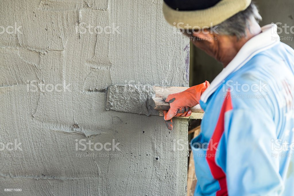 plasterer man and his job stock photo