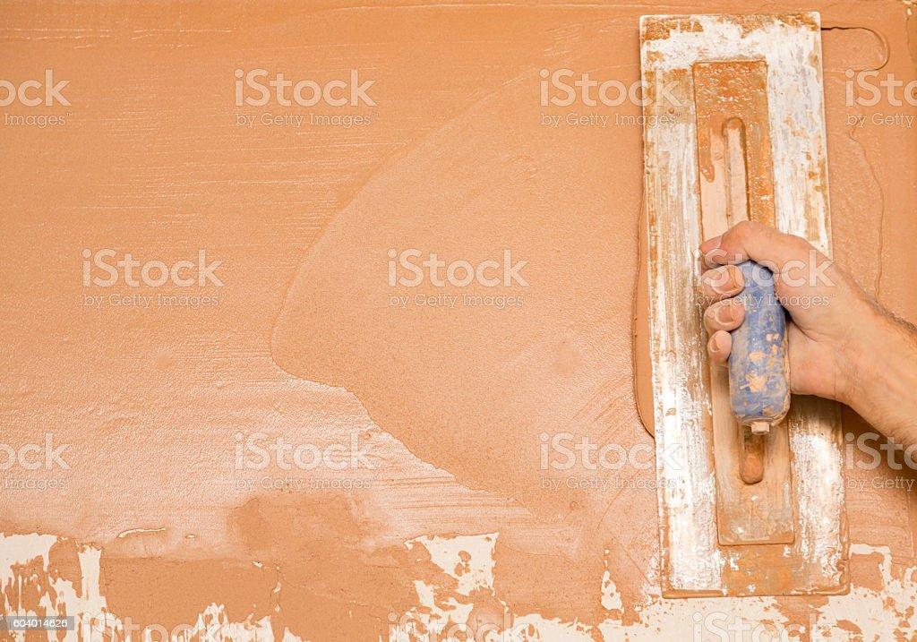Plasterer plastering a wall stock photo